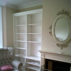 A fully fitted alcove unit. The columns are made to match the ones on the fireplace (Sydenham)