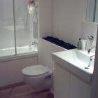 This bathroom we did the bath panel, vanity unit, hideaway, tiling, and fitting of the oak floor   (Warwick Avenue)
