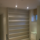 Bespoke bookcases fitted to the master bedroom painted with clients choice colour   (West Dulwich)