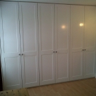 Shaker style wardrobes fitted to bedroom and finished in a white eggshell paint (Blackheath)