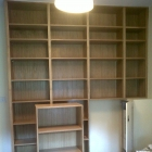 Bespoke oak veneered bookcase with pull-out section to allow access to boiler(Camberwell)