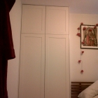 Shaker style wardrobes fitted to bedroom alcove finished in a white eggshell paint(Camberwell)