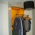 Full height wardrobes with pull down mechanism to maximise hanging space (Greenwich)