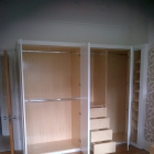 L shaped bespoke wardrobe complete with slanted shoe rack 