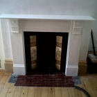 Fire surround made in MDF to match existing fireplace which is cast iron to adjoining room   (Greenwich)