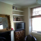 Floating shelves fitted to living room alcove and finished in a white eggshell paint (Primrose Hill)