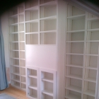 Bespoke home libaray with brass bookcase strip and sprayed in a white finish (St John's)