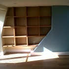 Oak floating shelves to odd shape alcove in new loft conversion (Tooting)