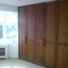 Wardrobes in walnut solids and