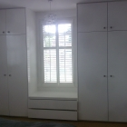 Wardrobes with a window seat in the middle all doors and drawers have a soft close mechanism (Wanstead)
