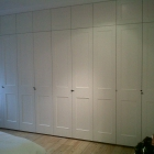 Shaker style panel moluded wardrobes fitted to bedroom and finished in a white eggshell paint (Dulwich Village)