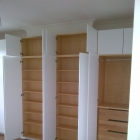 Plain wardrobes across chimney with ash carcase and slow close doors(Forest Hill