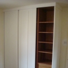 Wardrobe to a Georgian property with sliding doors to match room panelling  (Spitalfields)