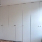 A modern wardrobe built along full length of wall, scribed in due to unlevel ceiling of period property  (Waterloo)