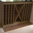 Custom built wine rack in solid and veneered oak fitted to under counter (Greenwich)