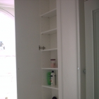 A tall vanity unit with adjustable shelves and moulded panel doors (Kensington)