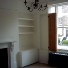 A plain modern alcove unit with floating shelves above (Camden)