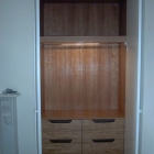 The inside of one of our wardrobes, lined in oak veneer, with drawers (Camden)