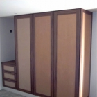 Wardrobes with shaker style doors leather inserts to be provided by an independent upholster (Kensington)