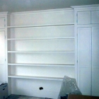 Bespoke wardrobes to fit bedroom alcoves with additional matching shelves running across chimney breast(Kensington)