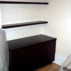 Walnut unit with floating shelves above (Ladbroke grove)