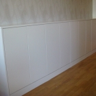 A long bespoke unit hand painted in white eggshell (Greenwich)