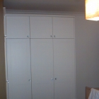 Bespoke corner wardrobe designed to maximise space - see opposite photo to view the inside (Dulwich)